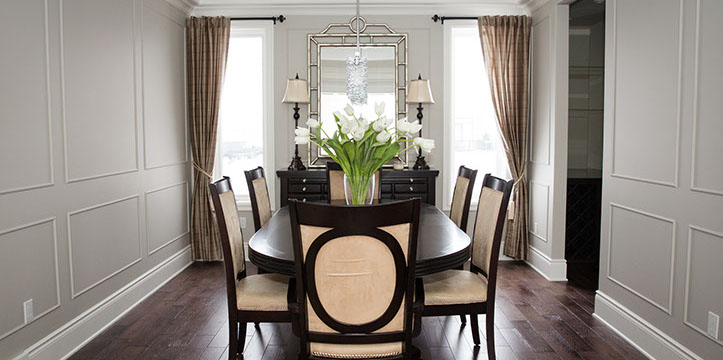 Dining Room With Brown Hardwood And Beige Chairs In Juliette Model Home London Ontario